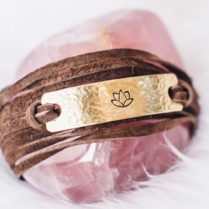 We rise by lifting others Brass & leather wrap bracelet